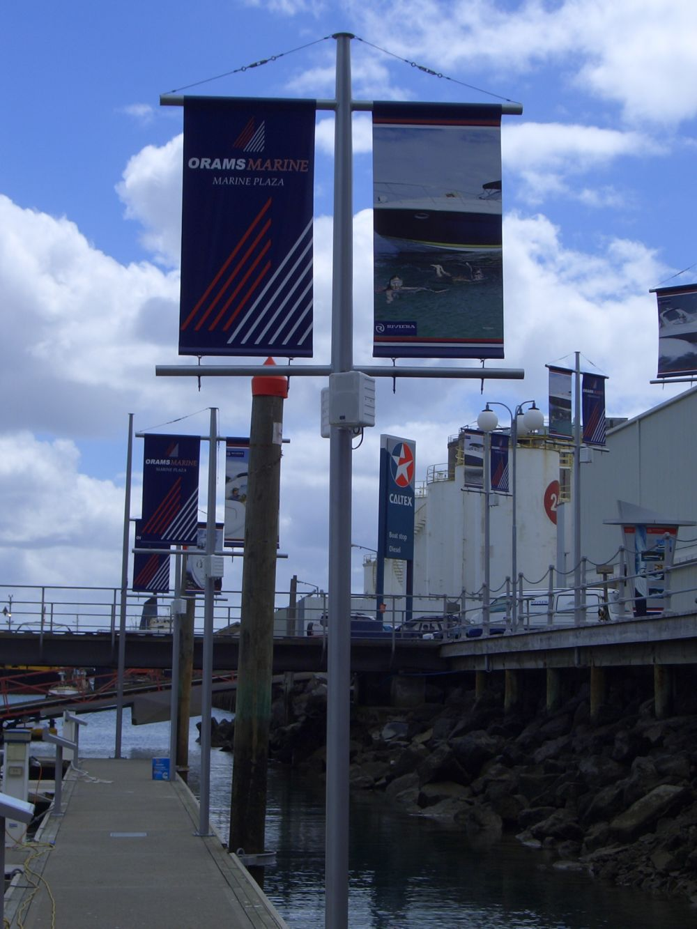 Banner poles on marina piers