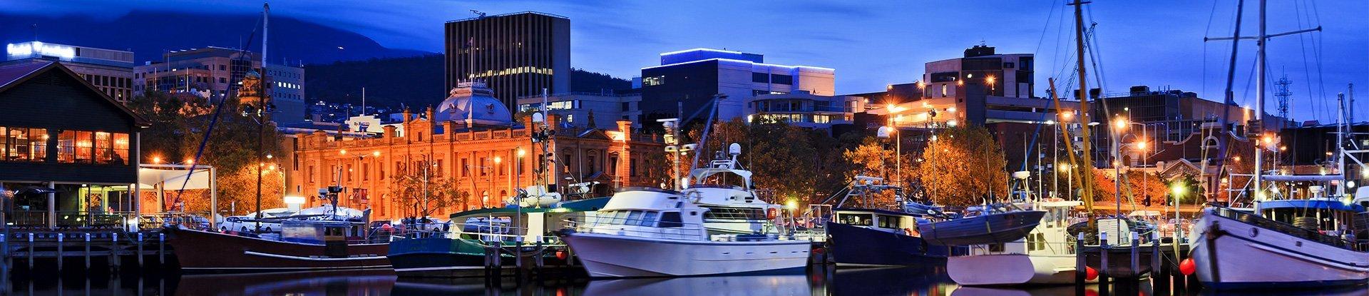 Yacht and boats docked at the city coast