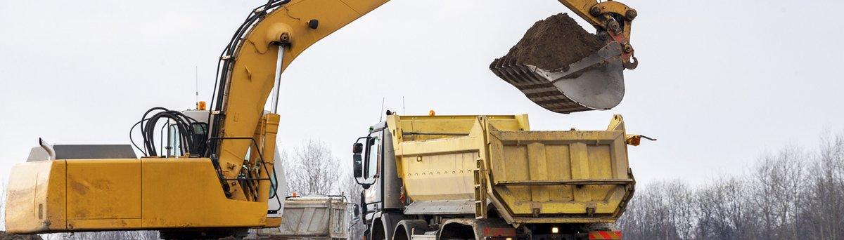 Digger loading a dumper truck