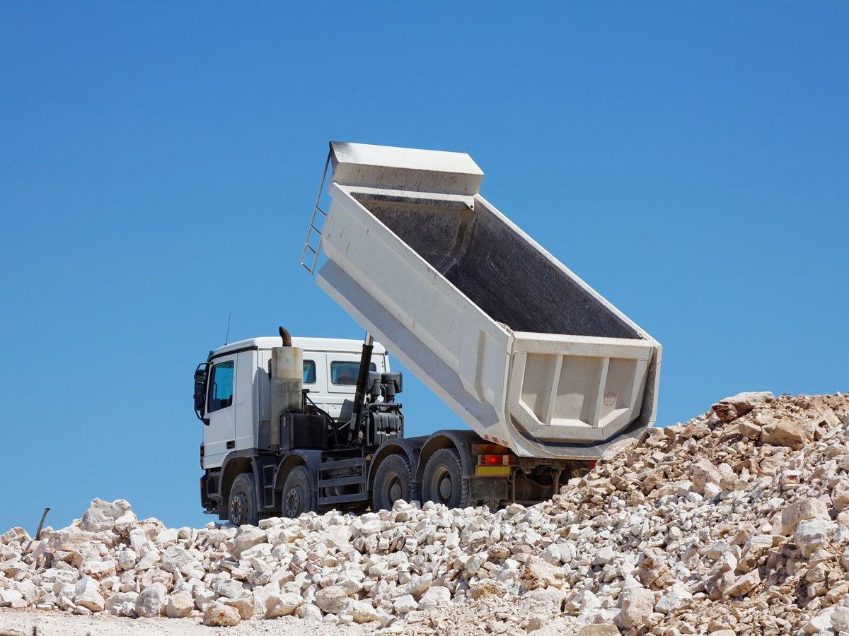 Dumper truck dumping load