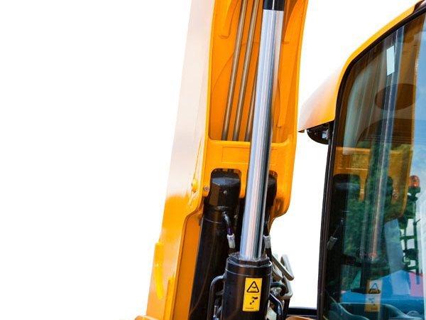 Fresh yellow epoxy coating on crane hydraulics