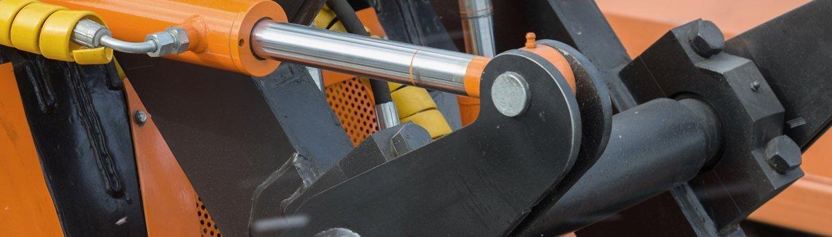 Large orange hydraulic cylinder