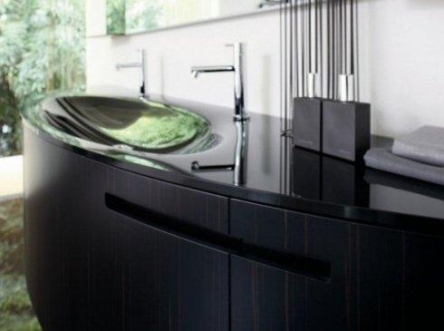 Mobile ovalado di legno scuro con lavandino di vetro