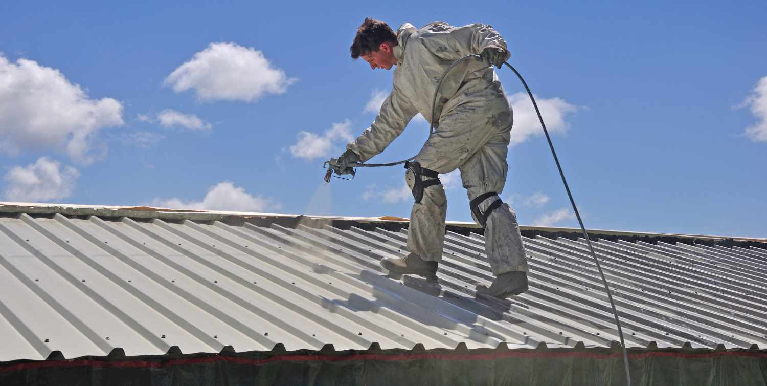 Painting the roof of a building