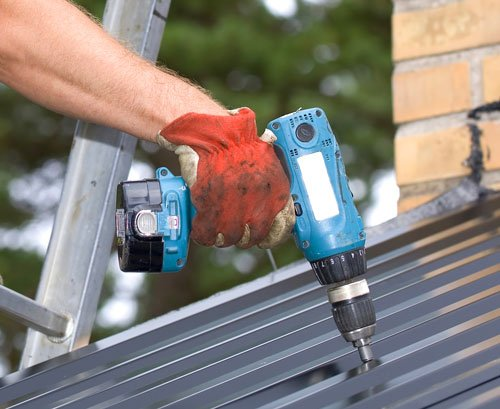 Working with a power drill on a roof in Whitefish