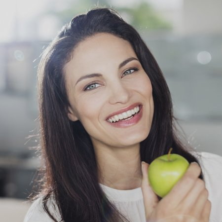 a lady holding an apple