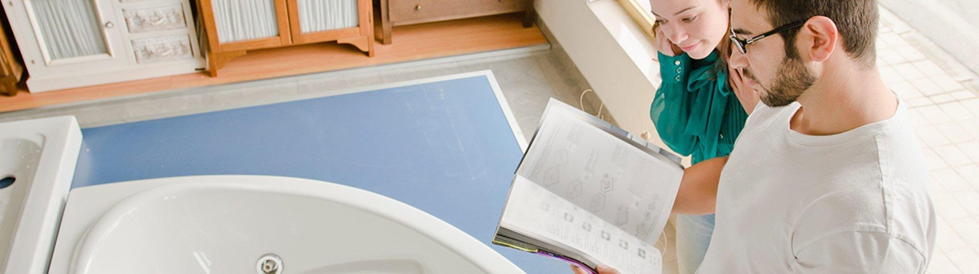 allpoints bathroom services tiled couple looking catalog of bath tub