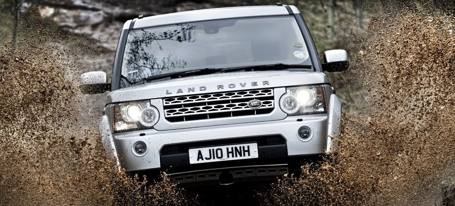 Close up of a Land Rover Discovery driving through water