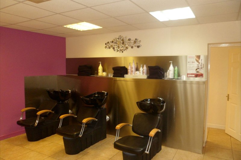 three styling chairs in salon