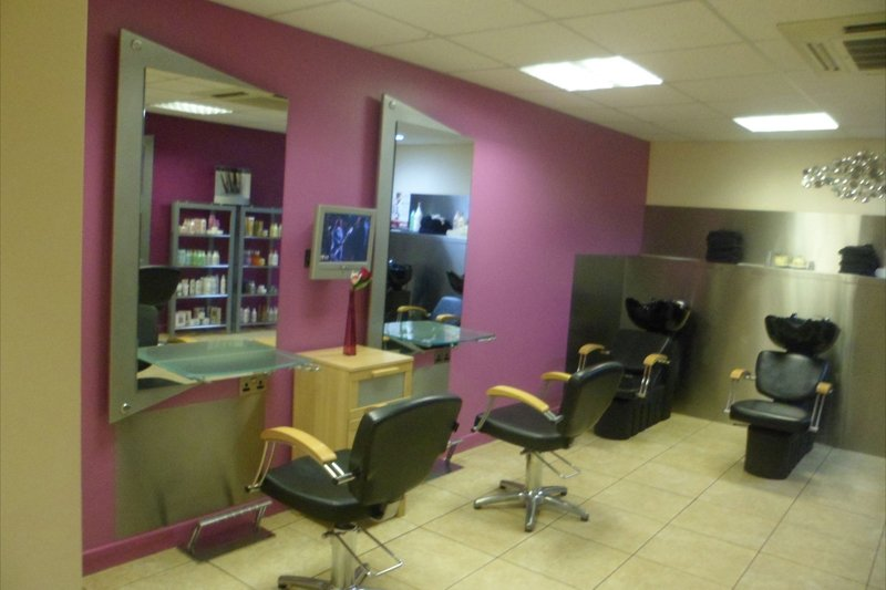 styling chairs in pink and gold salon