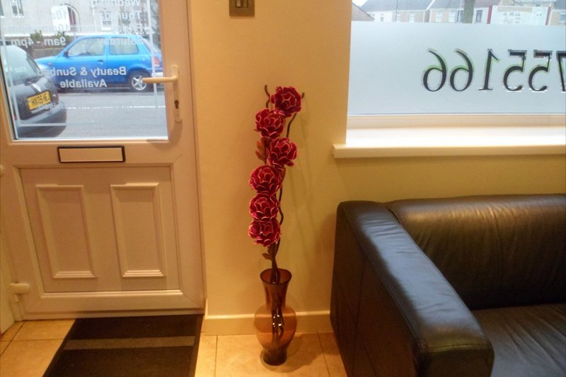 salon door with artificial flower nearby