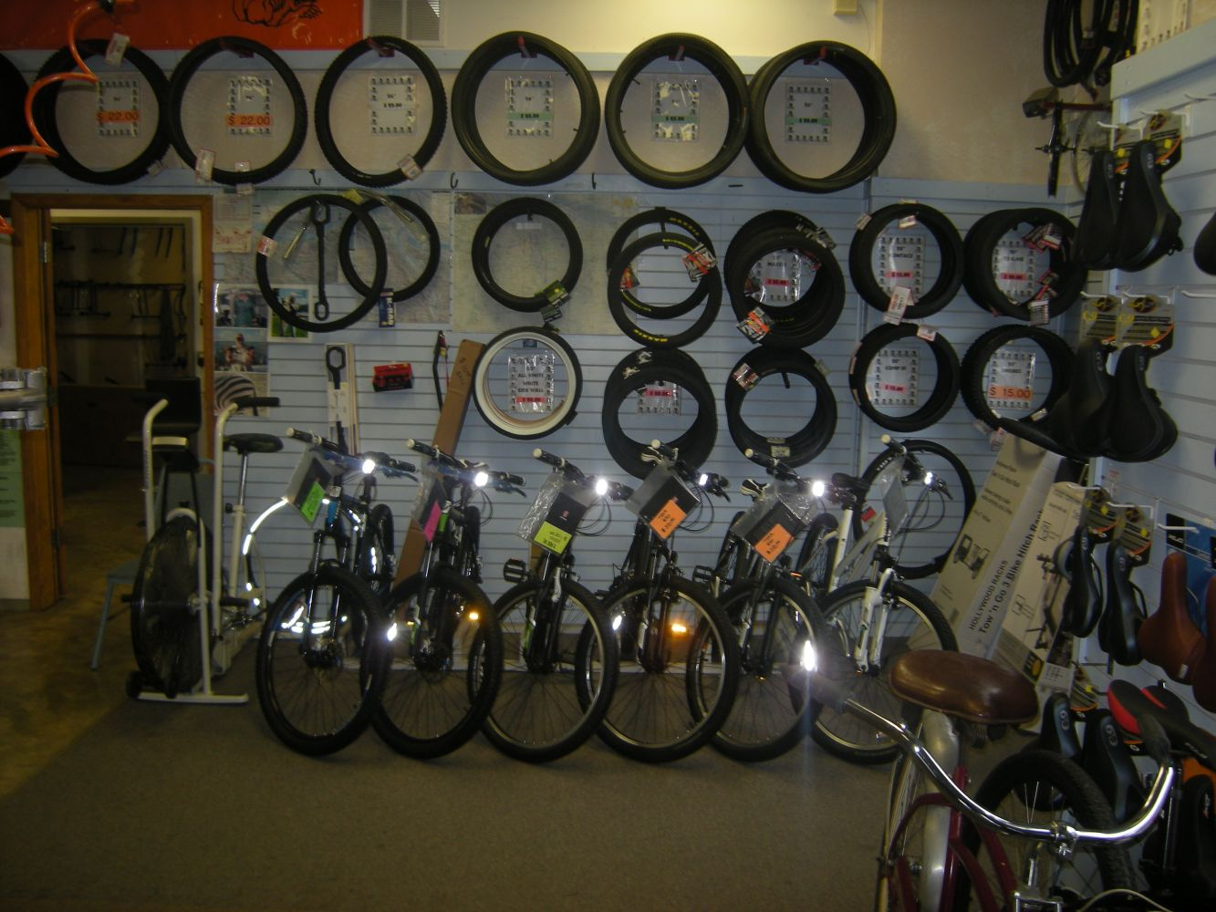 Canby Bikes N More Man making bike repairs to