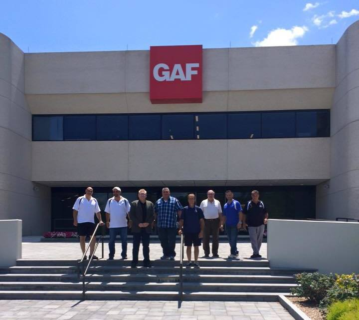 King Quality Construction employees take a photo outside of GAF headquarters.