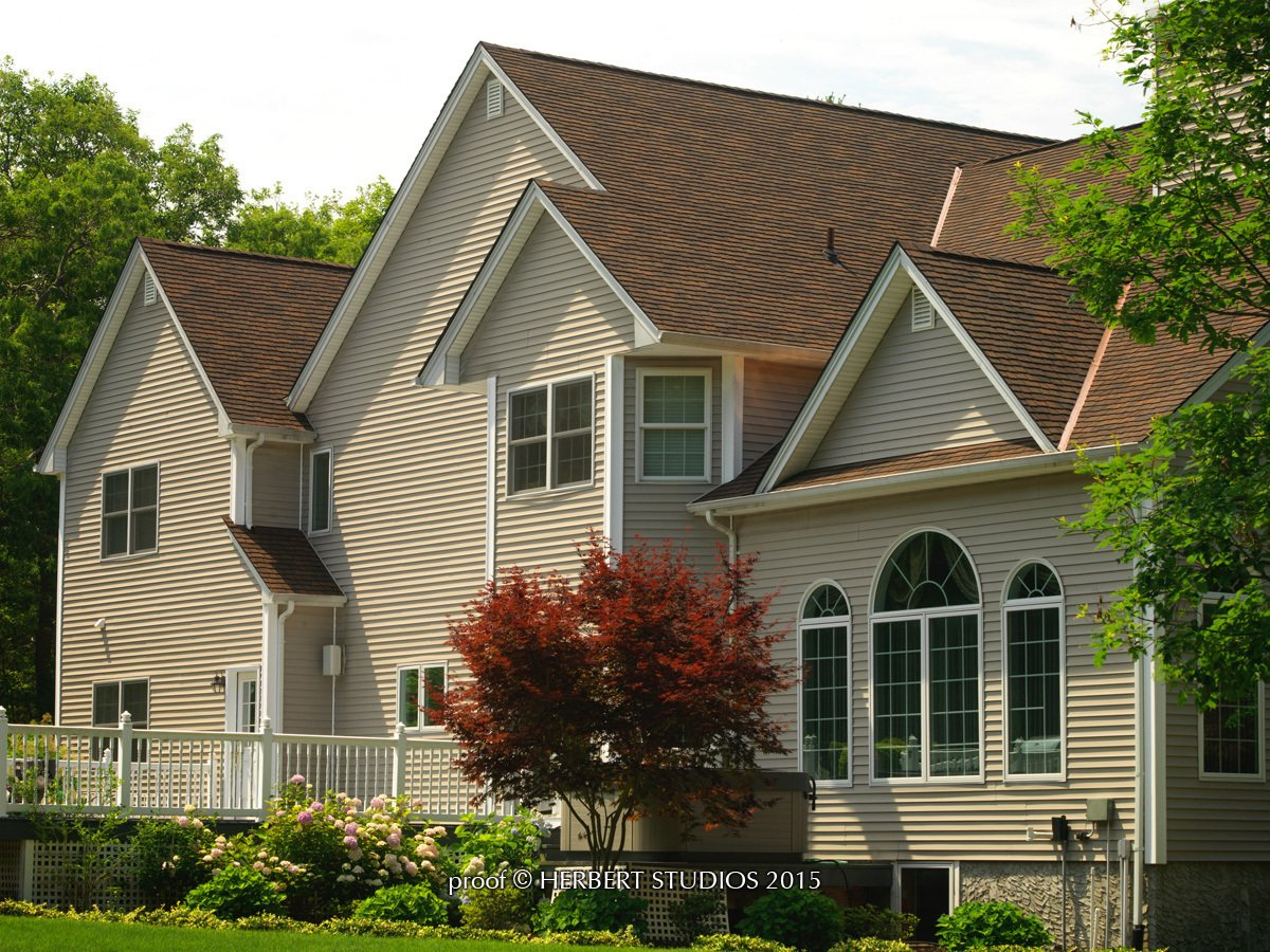 Angled front view of home with Glenwood Lifetime Designer Shingles, installed by King Quality Construction