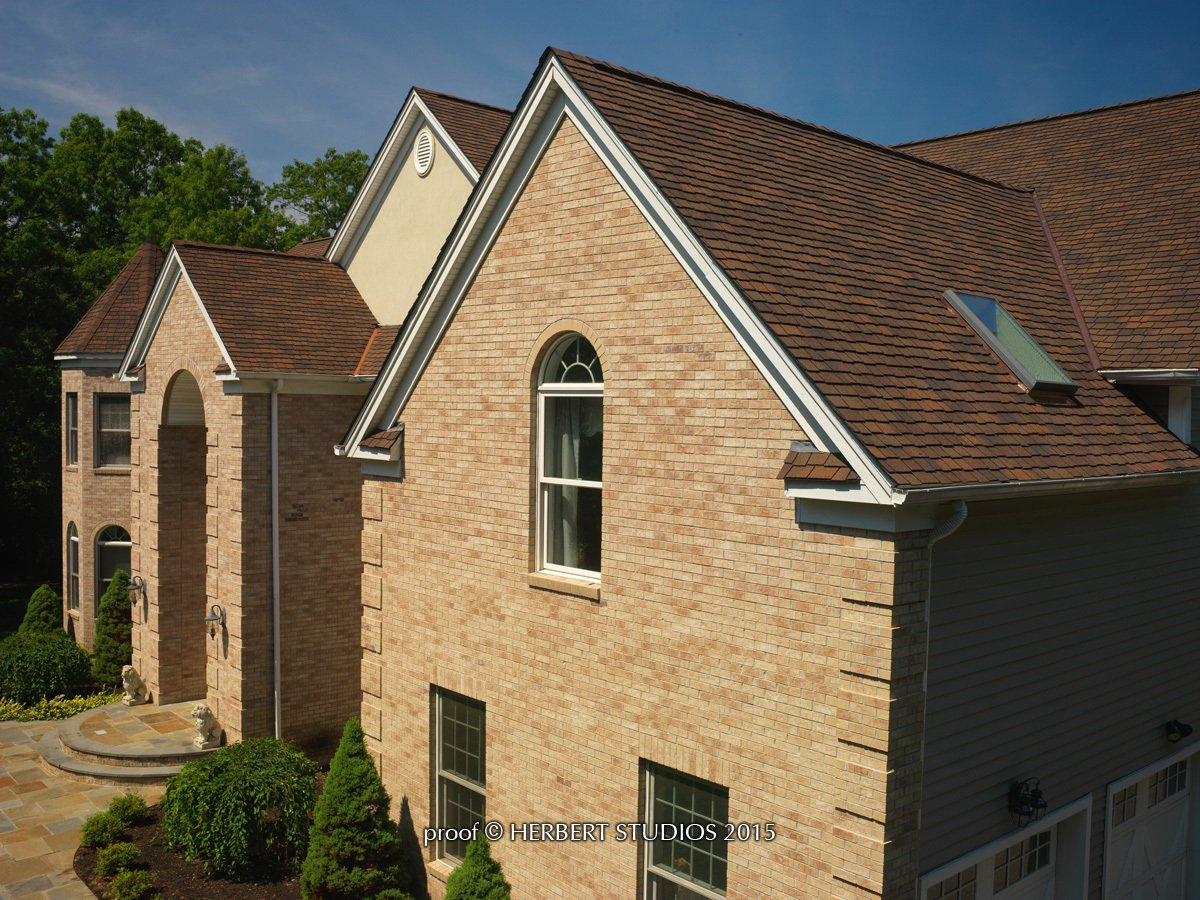 High angle view of light brick home with Glenwood Lifetime Designer Shingles, installed by King Quality Construction