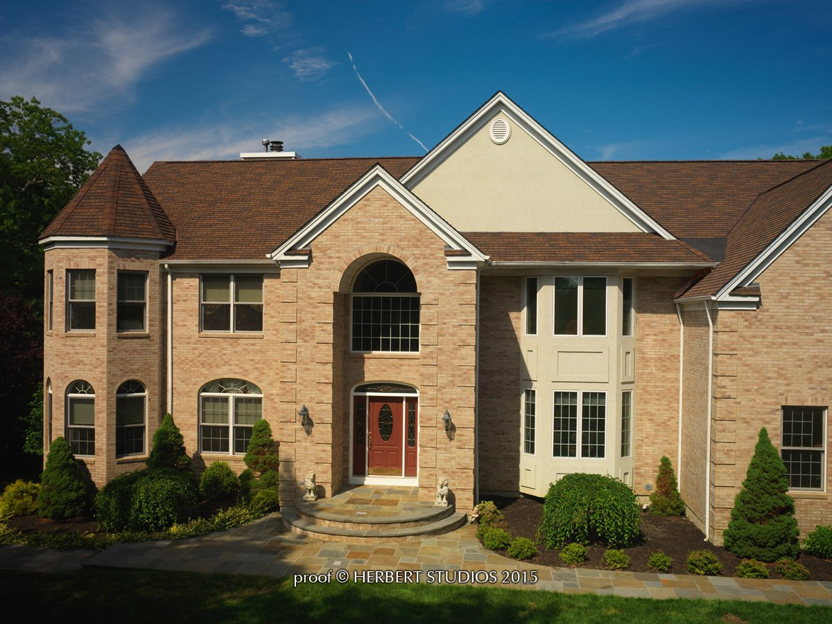 Light brick home with Glenwood Lifetime Designer Shingles, installed by King Quality Construction