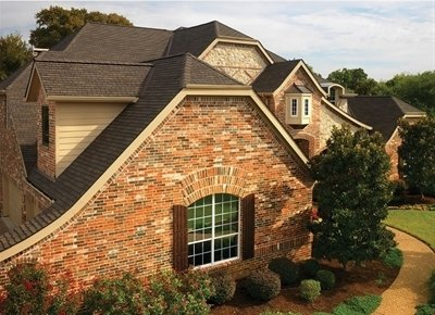 Brick home with roof with Glenwood Lifetime Designer Shingles, installed by King Quality Construction