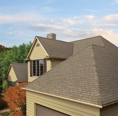 Roof of house with Timberline American Harvest shingles, installed by King Quality Construction