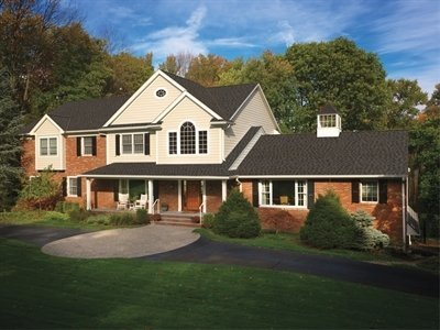 View of large house with Timberline American Harvest shingles, installed by King Quality Construction