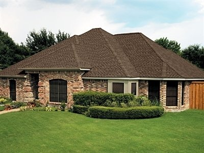 Brick house with Timberline HD shingles installed by King Quality Construction