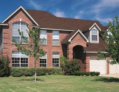Front view of brick house with Timberline Ultra HD shingles installed by King Quality Construction