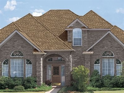Partial view of front of house with Timberline Ultra HD shingles, installed by King Quality Construction.