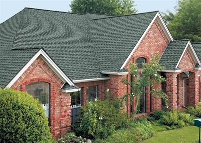 High angle view of brick house with Timberline Ultra HD shingles installed by King Quality Construction.