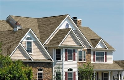 Upper portion of home with Timberline Ultra HD shingles installed by King Quality Construction