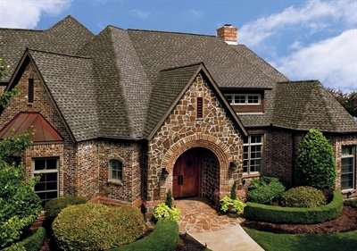 Home with large roof with Timberline Ultra HD shingles installed by King Quality Construction