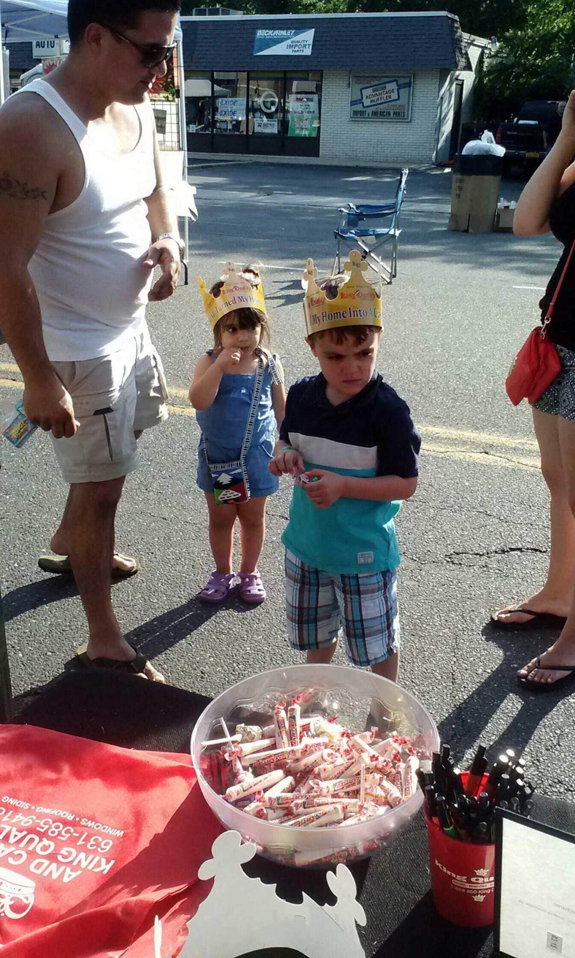 kids at the king quality construction booth at Centereach Street Fair