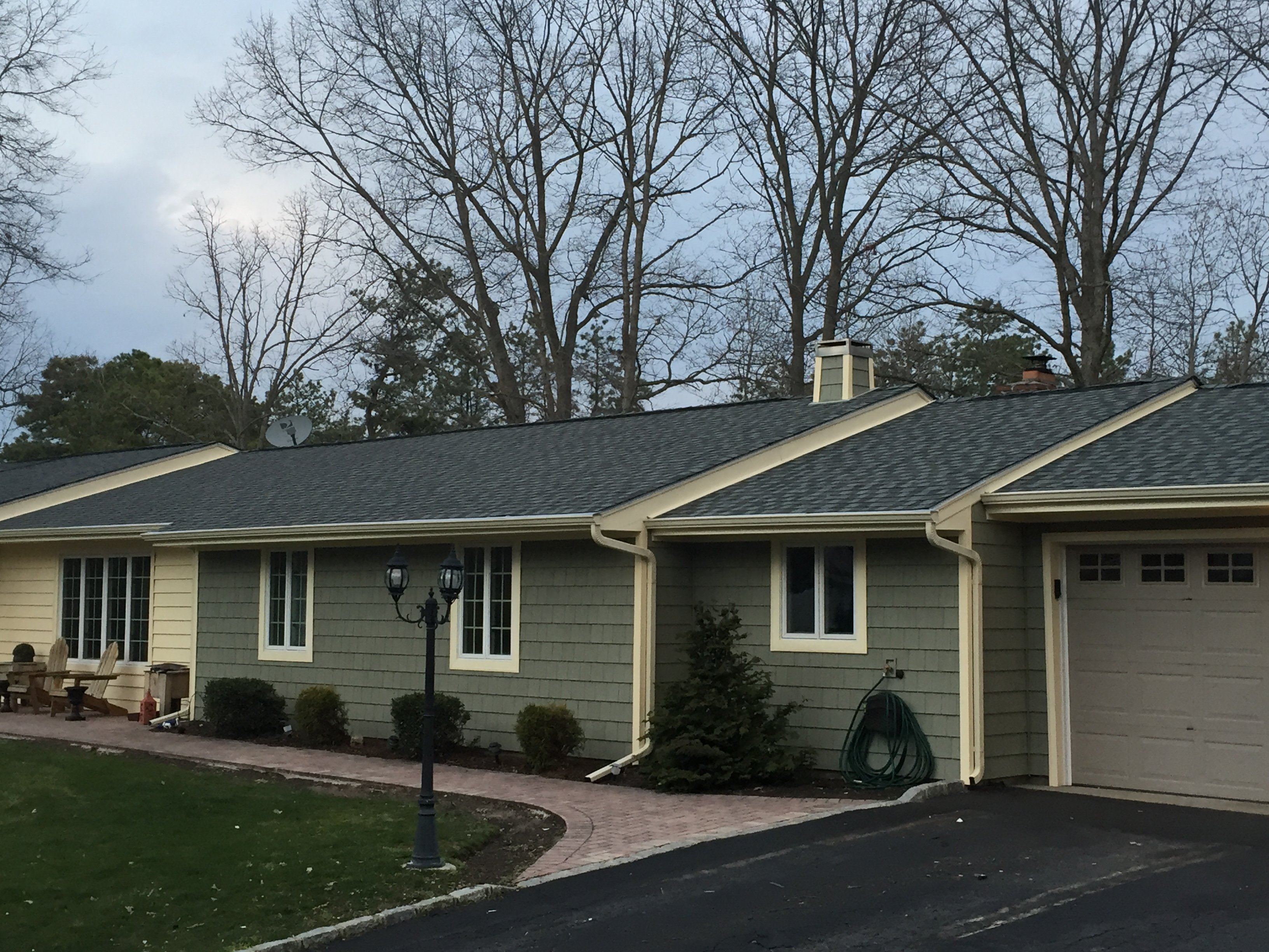 Front of house with siding done by King Quality Construction
