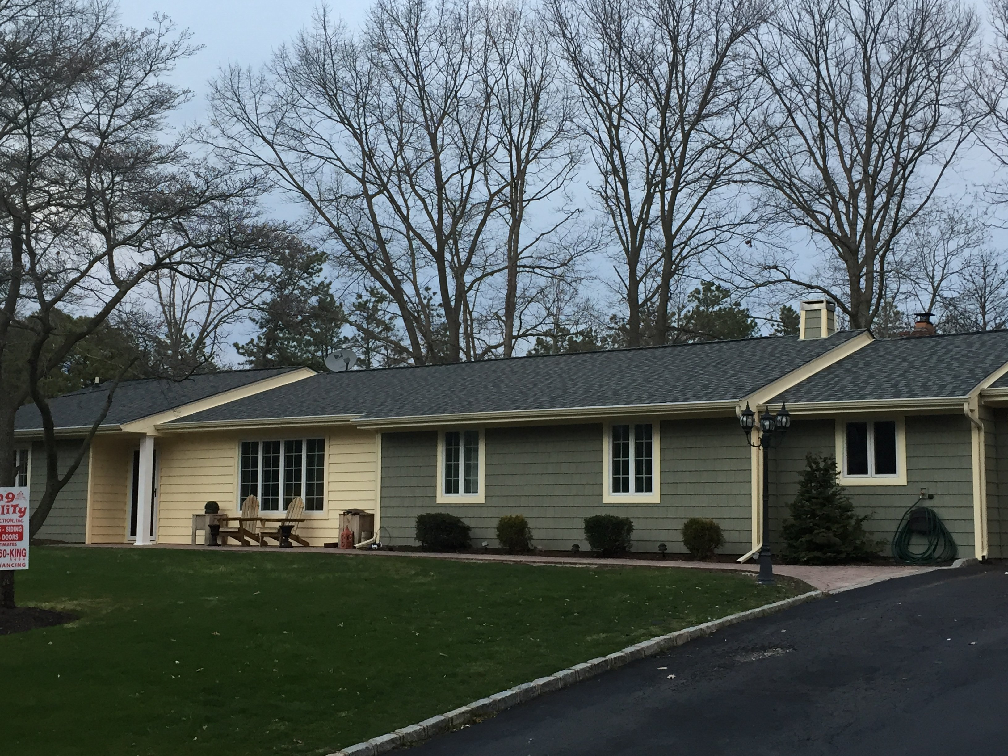 Wide shot of home with siding done by King Quality Construction