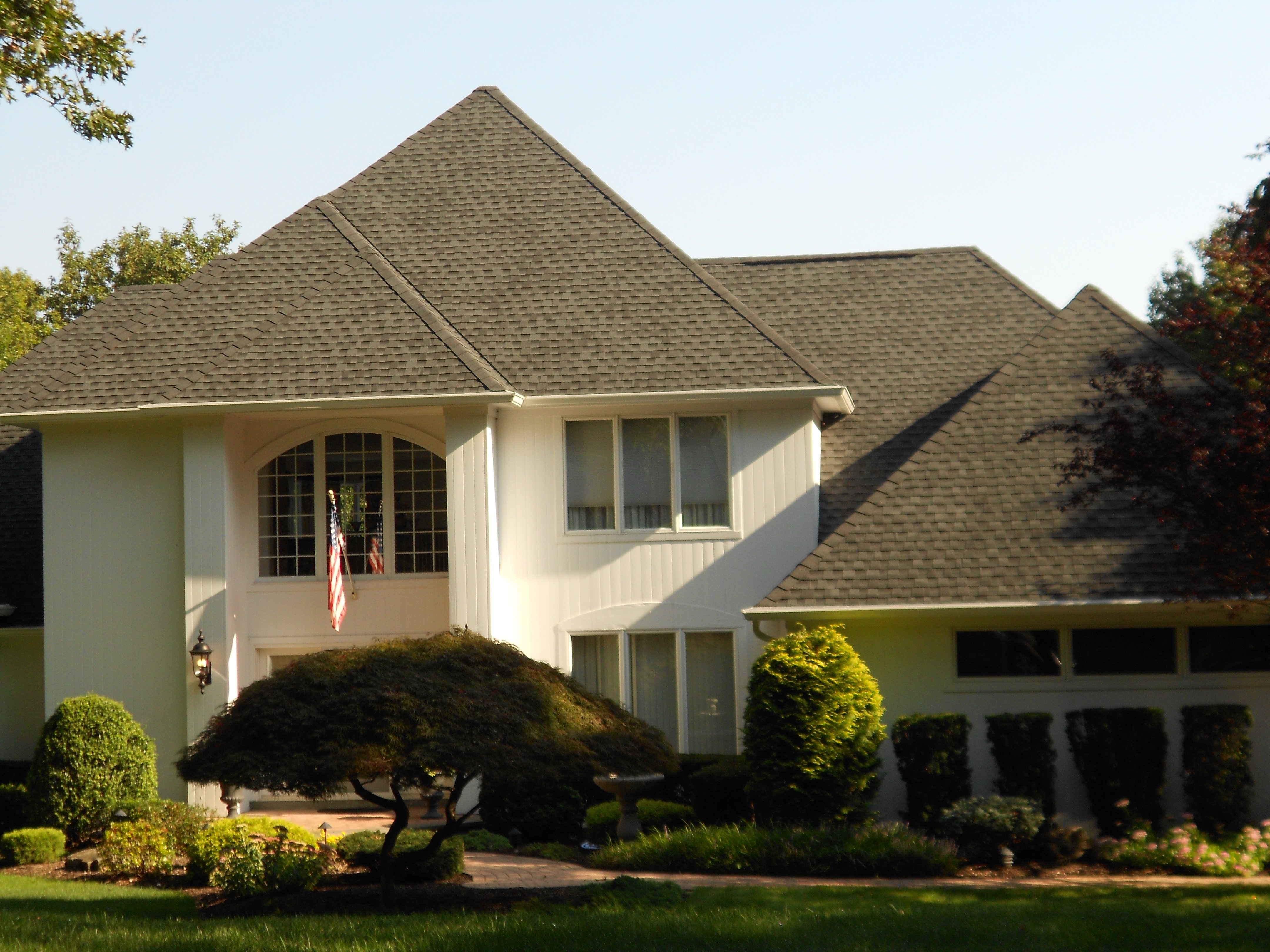 Full shot of house with roof installed by King Quality Construction