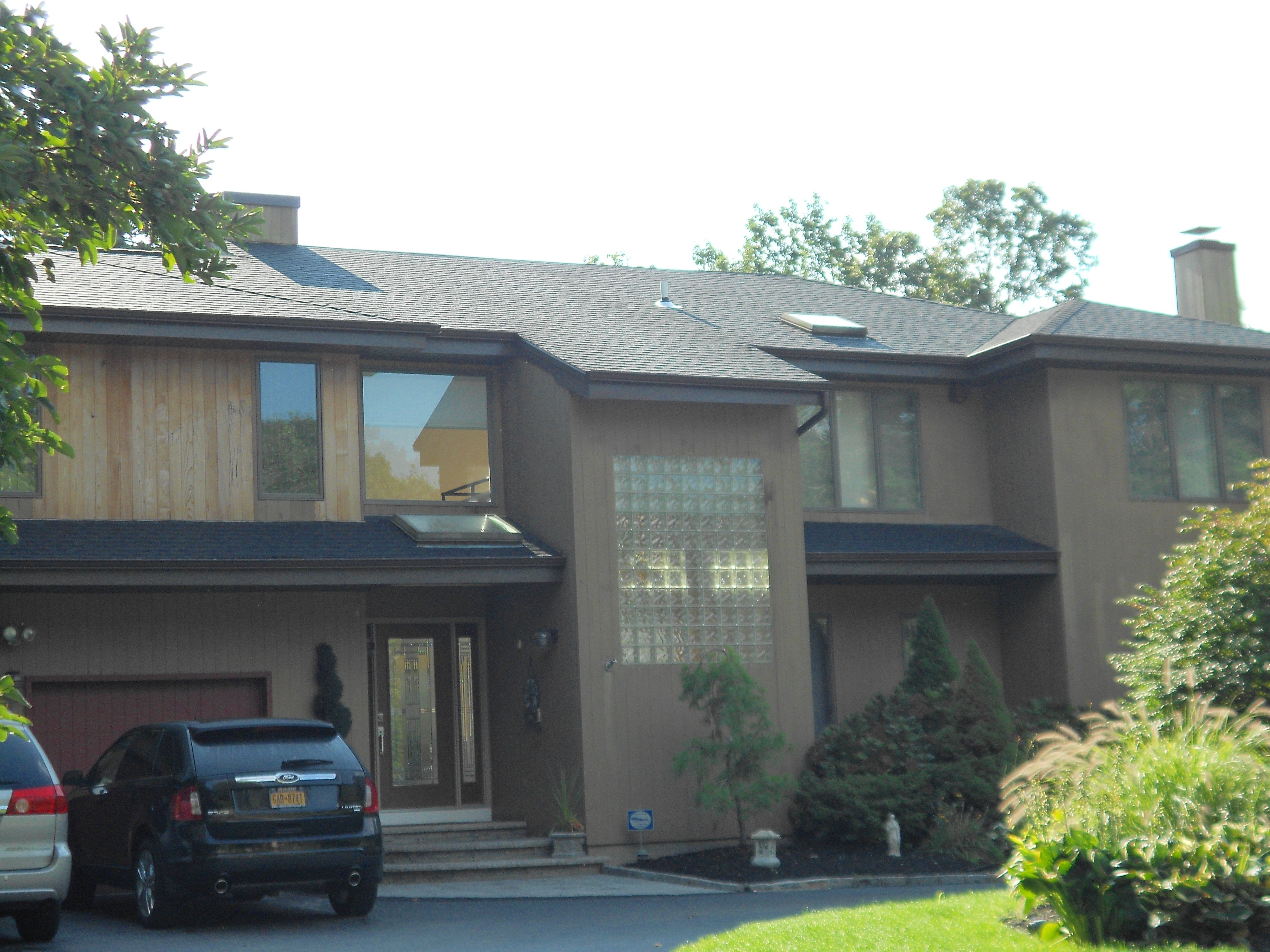Exterior of home with roof installed by King Quality Construction