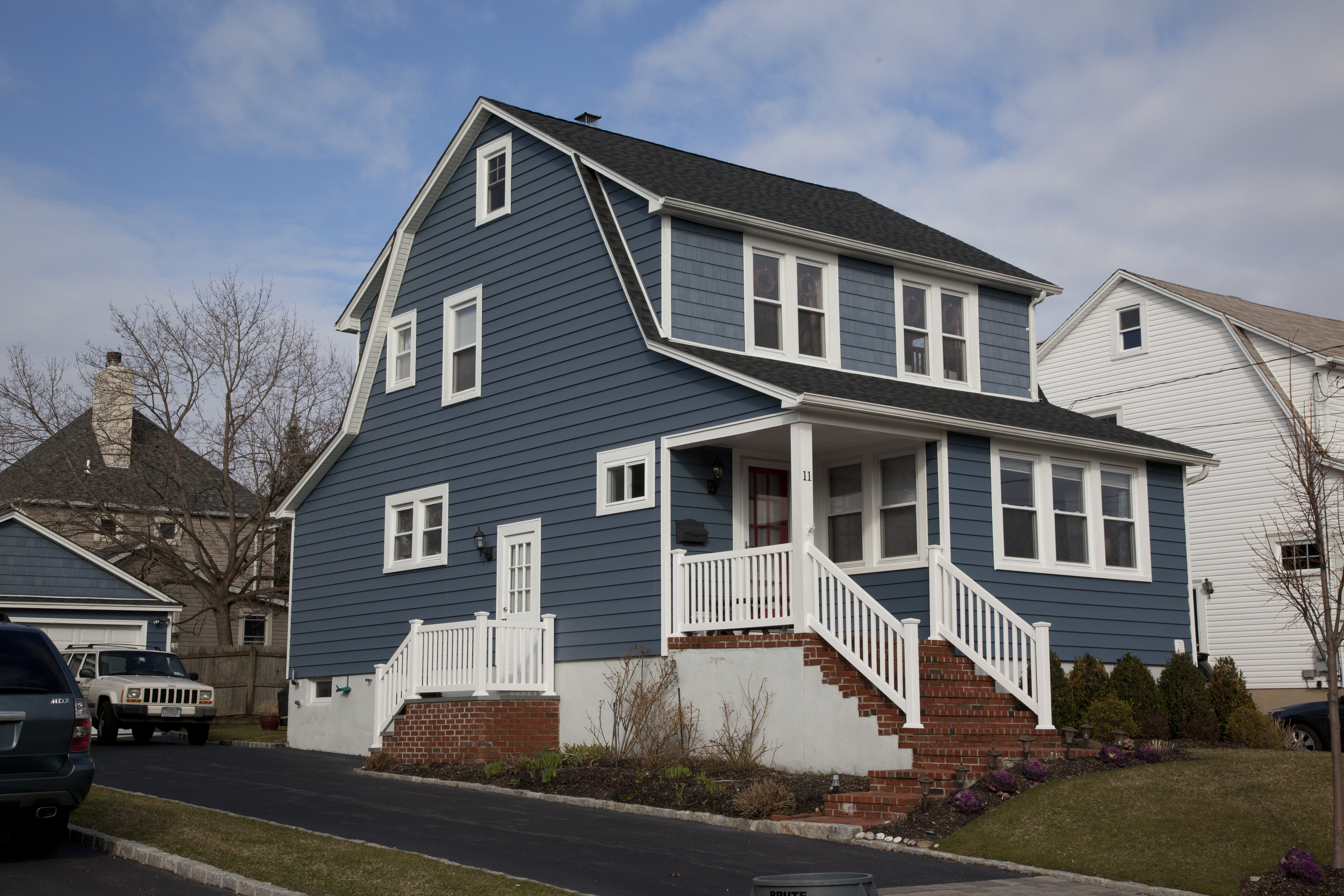 Full shot of house with siding done by King Quality Construction