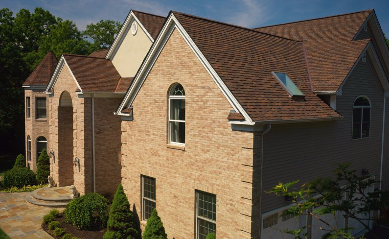 Roof of home with designer shingles, installed by King Quality Construction