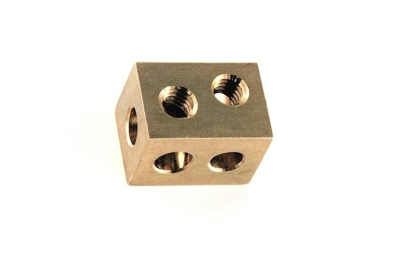 Perforated item in brass