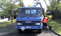 A truck performing vacuum loading services