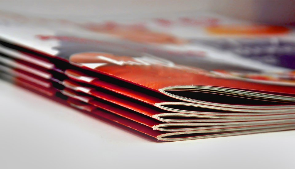 A close up of a pile of brochures