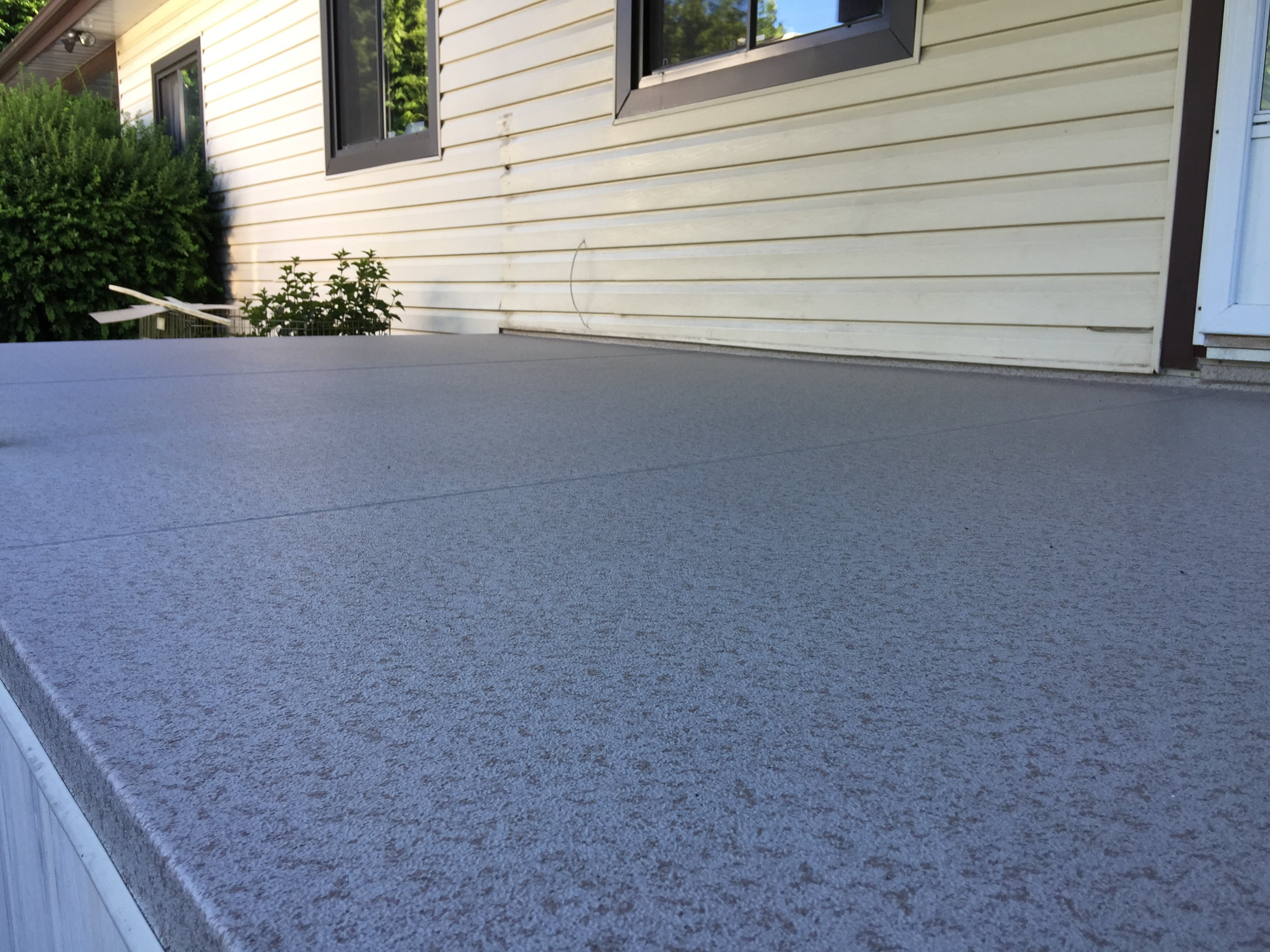 Grey vinyl with overlapping seems covering large deck