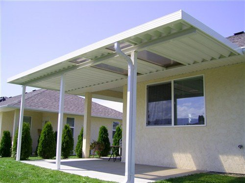 White patio top with two bronze acrylic skylights