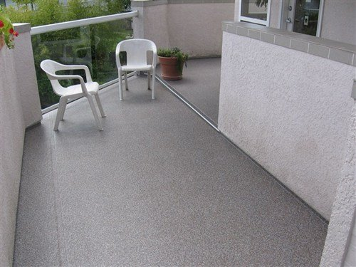 Grey vinyl with overlapping seams covering small porch