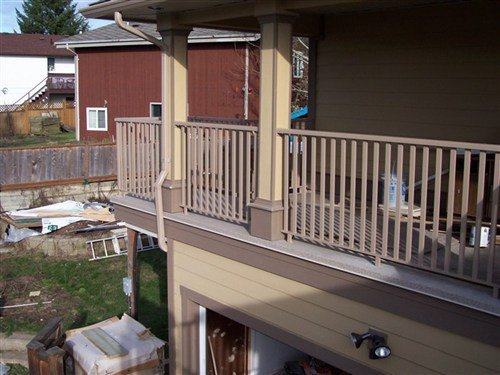 Beige fat boy picket railings attached to wrap around deck