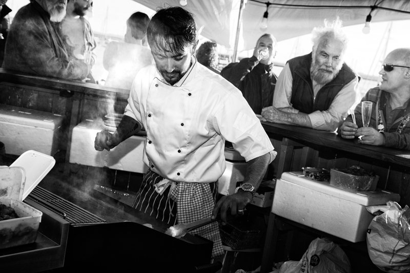 man preparing food at toms salty shack