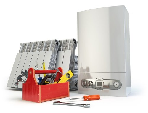 una caldaia, una cassetta degli attrezzi e dei termosifoni