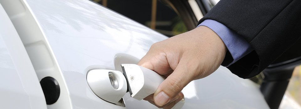 Chauffeur opening private car door