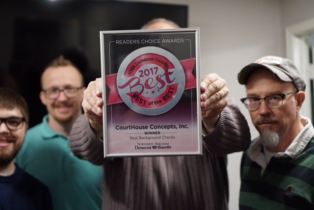 Courthouse concepts best of the best employees holding award