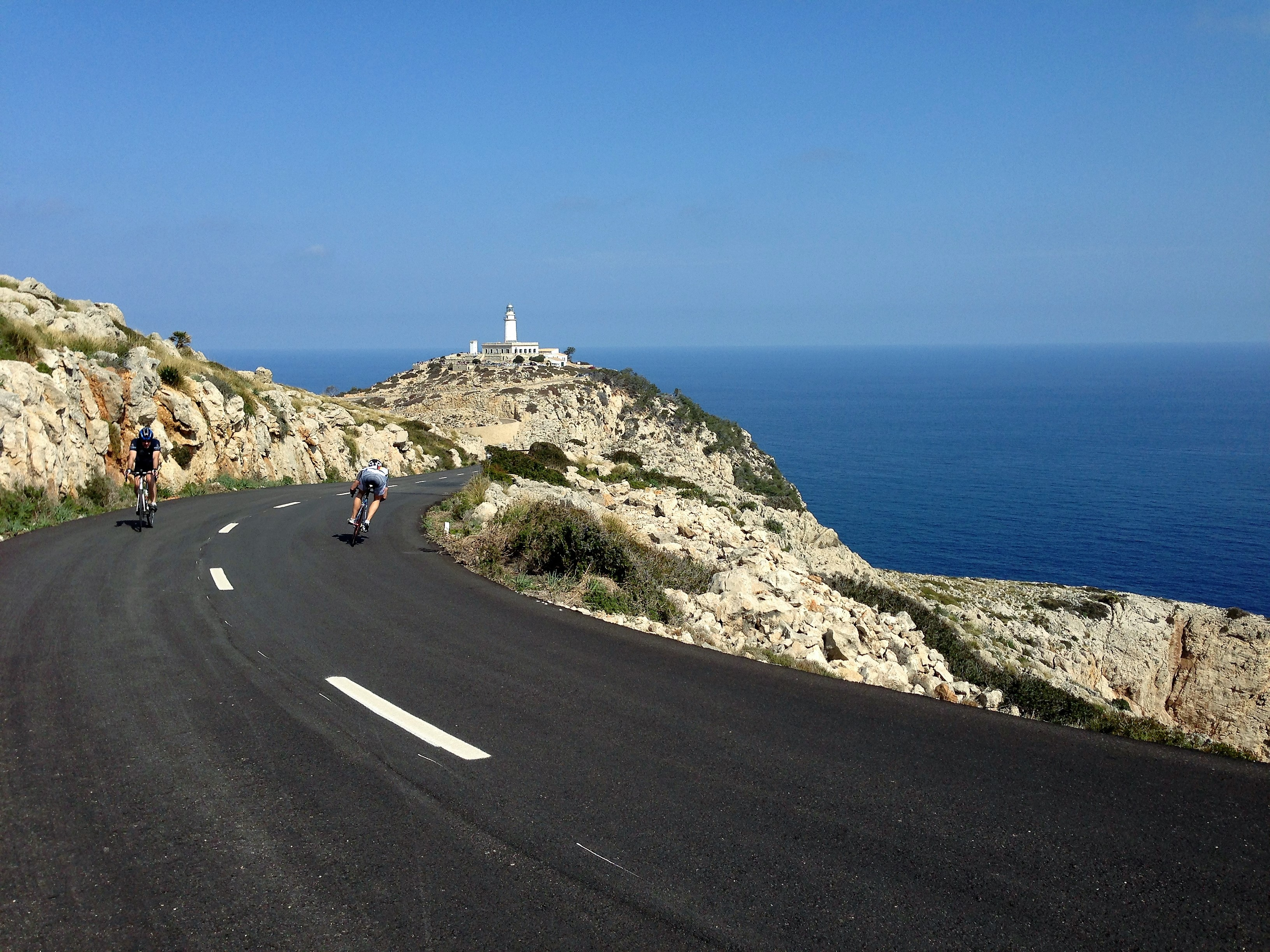 cyclists riding at cycling camp near Formentor Lighthouse