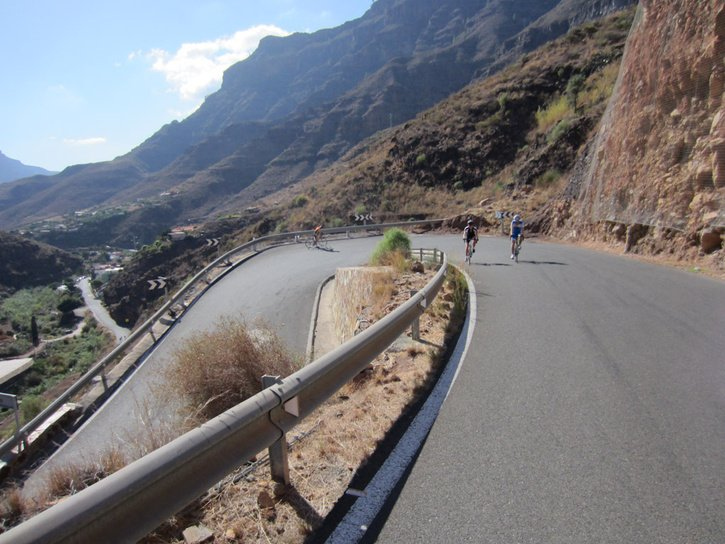 Cyclists climbing road in Spain