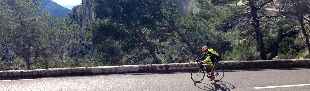 cyclist climbing at cycling camp in mallorca